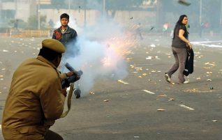 Cops firing tear gas to disperse mob